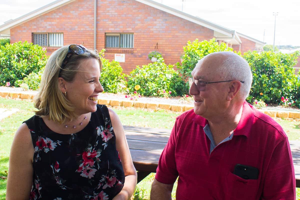 Melanie Mullen chatting with a Yukana resident.