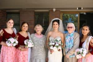 Bride with bridal party and Yukana residents