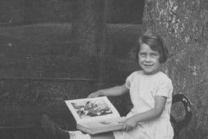 Betty reading in Bristol Park, England