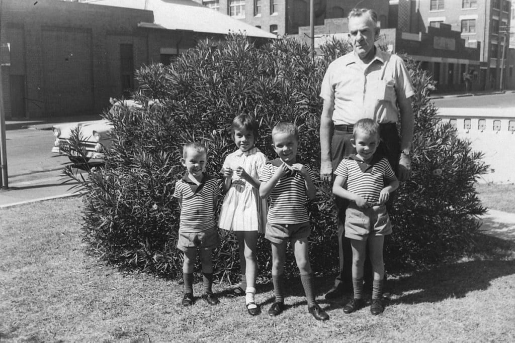children with their grandfather in 1964